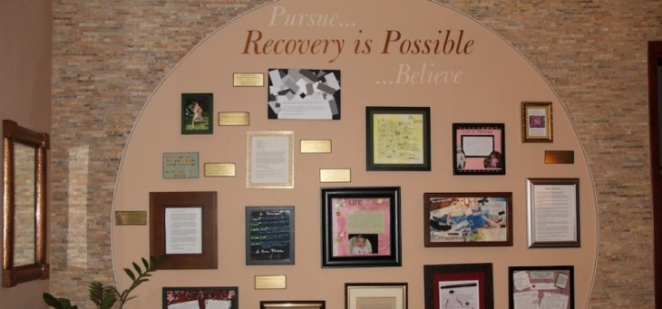 A New Beginning picture of the wall of recoverey showing letters and pictures of clients success